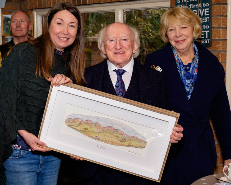 President Michael D. Higgins and his wife Sabina visited An Tobar in Silverbridge on Thursday and were presented with a beautiful piece of art depicting the Ring of Gullion from artist Sharon Donnelly Carragher. Photograph: Columba O'Hare/ Newry.ie