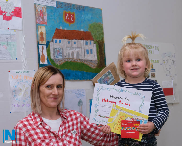 Malwina Swiercz was the winner in the 7-10 year old section at the Art Competition held by the Polish Supplementary School, Newry. Her mother Katorzyna and sister Laura are pictured with her awards. Photograph: Columba O'Hare/ Newry.ie