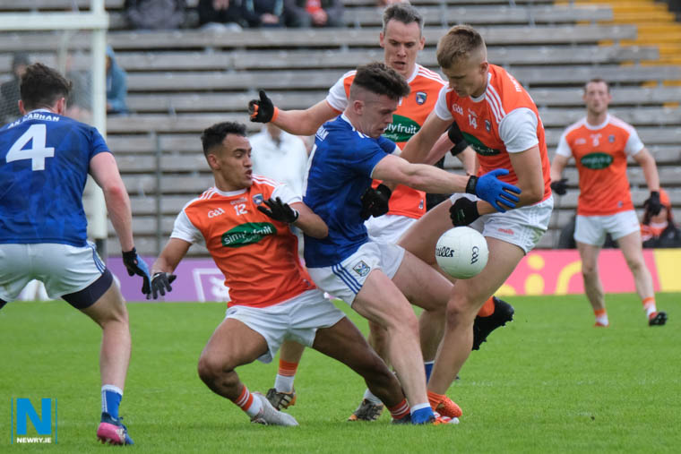Armagh's Rian O'Neill, Mark Shields and Jemar Hall close in on Cavan at Clones. Photograph: Columba O'Hare/ Newry.ie