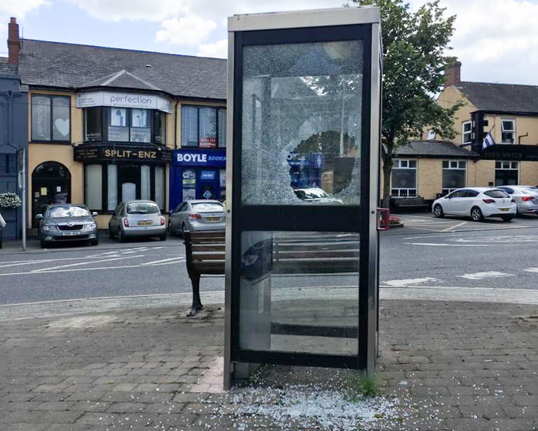 The vandalised telephone box in the centre of Camlough.