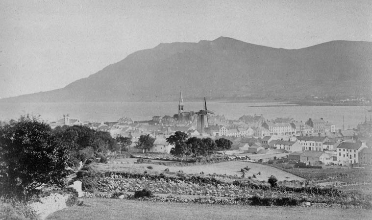 Warrenpoint and Carlingford Lough from the Bridle Loanan c.1900. This image shows the Windmill which was located just off the Square and had been built by Robert Turner in 1802. Newry and Mourne Museum Collection