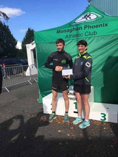 Barry McCarroll receiving his prize for 2nd place finish in Monaghan Marathon
