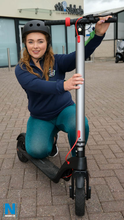 Orlagh Quinn with one of their E-Scooters. Photograph: Columba O'Hare/ Newry.ie