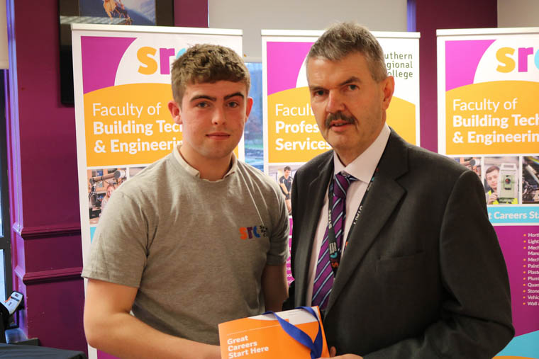 Cailim McNamee won Silver in Brickwork with John Muckian Deputy Head of Construction SRC