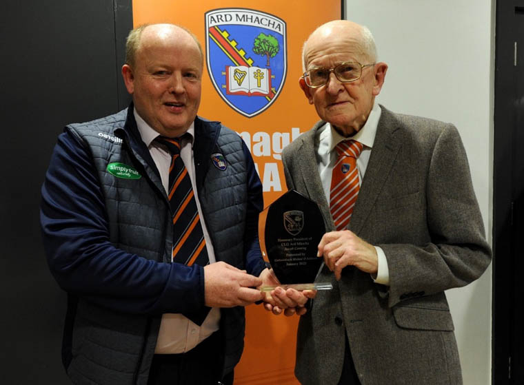 Armagh GAA County Chairman Michael Savage presents an award to Joe Canning.