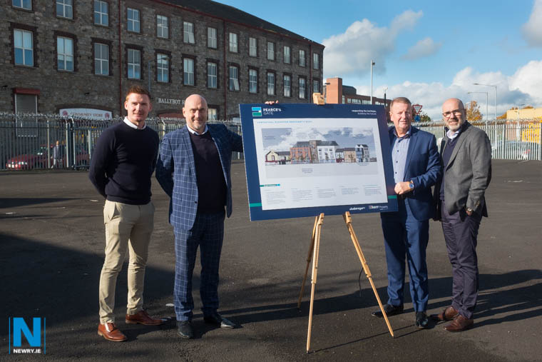 Looking at plans for the proposed Pearce's Gate development on the site of the former William Goss and Sons premises at Merchants Quay and Cornmarket, Newry. Included are from left: Andrew Burnside, Project Manager, Kerr Property;  Michael Rogers, Architect/ Director Studio Rogers Architects; Martin Conlon, Director, Kerr Property and Barry Owens, Consultant. Photograph: Columba O'Hare/ Newry.ie