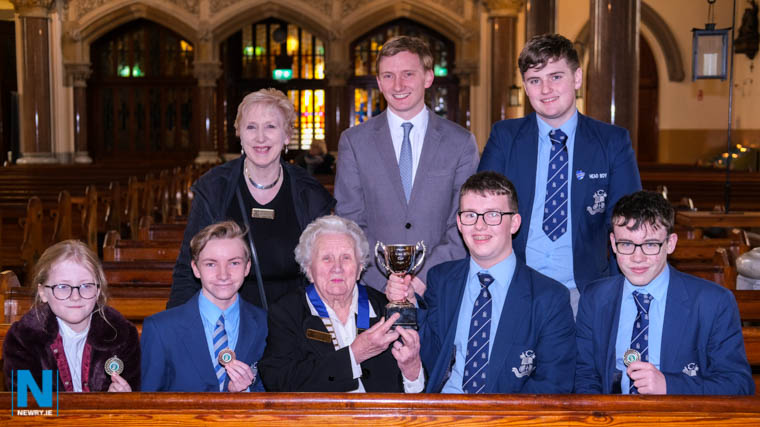 Pictured at the Newry Musical Feis Organ Solo (Open) Competitions at St Catherine's Dominican. Alma Brown, President, Newry Musical Feis presents the Alma Brown Cup to Harry McMahon, Burren, winner in the Junior class. Looking on are from left: Annie Diamond, Castledawson, Novice class winner; Daire Downey, Bronze in Junior class and Terry Rafferty, Silver in Junior class. Back: Dr Mary Goss, Feis Administrator; David Grealy, Adjudicator and Eoin Cassidy, Gold in Intermediate class. Photograph: Columba O'Hare/ Newry.ie