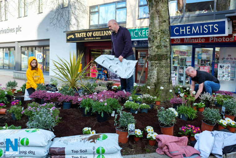 Grace and Garry McElherron and Jonny McCullagh hard at work planting in Marcus Square, Hill Street, Newry as part of an initiative by Newry 2020 supported by Live Here Love Here. Photograph: Columba O'Hare/ Newry.ie