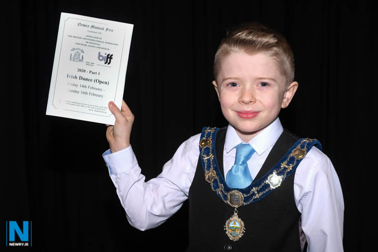 The usual  Deputy Newry, Mourne and Down Council Chairperson  Cllr Terry Andrews had a welcome break from duties at the launch of Newry Musical Feis, when young Irish Dancer, Niall Keenan from Killeavy took  on the role briefly at Newry Town Hall.  Photograph: Columba O'Hare/ Newry.ie