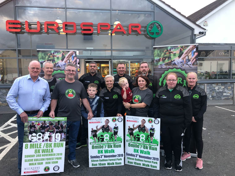 Members of the Slieve Gullion Runners  with Alfie's Dad Jamie  his sister Leigh-Jane and her two kids Johnny and Stephen with Terry Mulkerns from Mulkerns' Eurospar