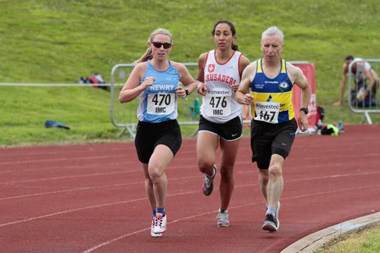 Sarah Jane Beattie (Left) in the lead pack with Pat Rocks of NCR (Right)