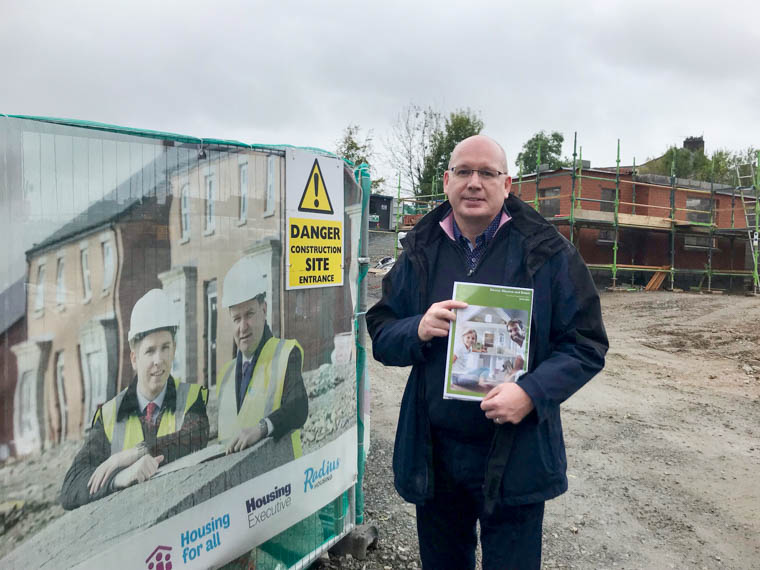 Cllr Michael Savage with a copy of the Housing Investment Plan detailing over 700 homes for Newry City.