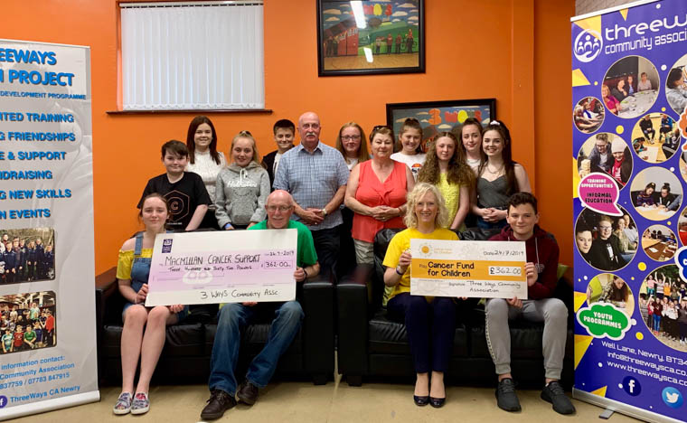 Three Ways Youth Project accompanied by NMDDC Chairperson Cllr Charlie Casey and TWCA Chairperson Cathy Keenan presenting the cheques totalling a tremendous £764.00 to Macmillan Cancer and Cancer Fund for Children.