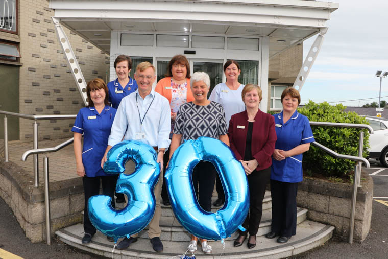 Liz Cuddy CEO Southern Area Hospice congratulates Staff members who have been with the Hospice since it opened in September 1989 now celebrating their 30th Anniversary. Back row l-r Bernadette Duncan Staff Nurse, Maureen O'Hare Support Services Manager, Angela Fegan Nursing Auxilary, front row  l-r Angela McCartney Staff Nurse, Dr. Osmond Morris, Liz Cuddy CEO, Sheila McGivern Reception and Jacqueline McAteer Staff Nurse.