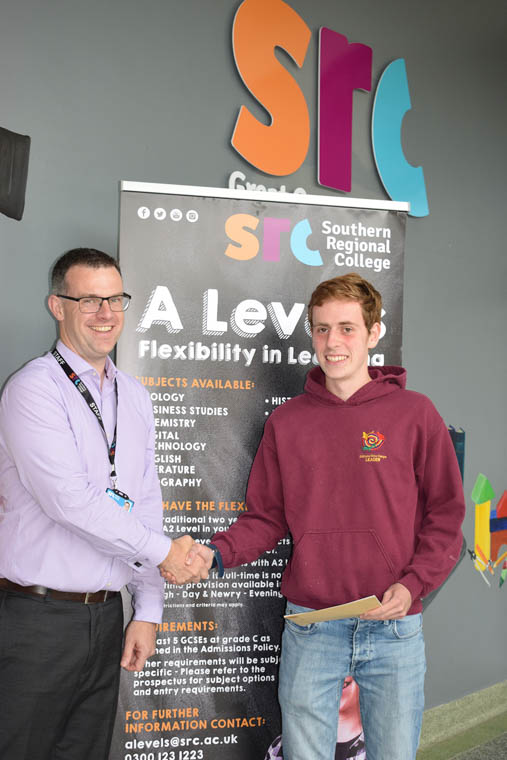 Micheal Curtis from Newry achieved AAAA grades in his four AS Levels, pictured with SRC Deputy Head of School Henry McCloy