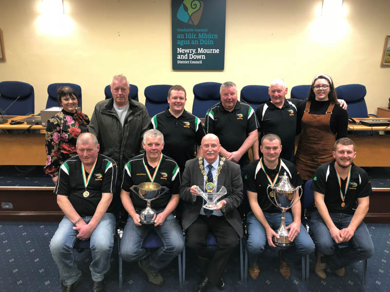 Newry, Mourne and Down Council, Chairperson, Councillor Charlie Casey presenting an inscribed bowl to members of the Newry Pike Anglers to mark their recent achievements in their sport.