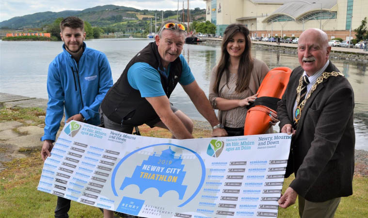 Launching the 2019 Newry City Triathlon. Included from left are: James Kernaghan with Dessy McMahon from C A Solutions on bicycle, Nicole McAteer from Newry BID, and Councillor Charlie Casey, Chairperson, Newry, Mourne and Down District Council.