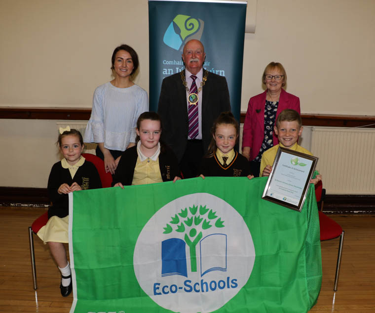 St. Patrick's Primary School Mayobridge received their first Green Flag at the Annual Eco-Schools Green Flag Ceremony in Warrenpoint Town Hall. Back from left: School  Eco Co-ordinator Mairead Trainor, Chairperson Newry, Mourne and Down District Council, Councillor Charlie Casey, Dorothy Corkin Eco-Schools Assessorr. Front:  Rose Dawks, Mia Farrelly, Ellen McCoy, Eoghan Rooney Eco School Council.