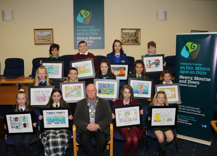 Chairperson Newry, Mourne and Down Council, Councillor Charlie Casey with the winners of the Schools Environmental Calendar Poster Competition. Included are front row from left: Rachel McGrath St. Mary's Primary School Barr (January), Ciara Hoey St. Joseph's High School Crossmaglen (February), Chairperson Councillor Charlie Casey, Front Cover Winner Lara MacKenzie St. Mary's High School, Newry, Isla Bell Down High School Downpatrick (March), Middle from left: Sophia Daly St. Oliver's Primary School Carrickovaddy (April),  Nathan Farrell St. Malachy's Primary School Camlough (May), Ellie Alexander St. Louis Grammar School Kilkeel (June), Ceana Downey Sacred Heart Grammar School Newry (July), Maria McStay Carrick Primary School Burren (August), Back from left: Bella McCaughey Bunscoil Bheanna Boirche Castlewellan (September), Padraig Byrne St. Bronagh's Primary School Rostrevor (October), Anna Murphy Assumption Grammar School Ballynahinch (November) and Daniel Wood St Malachy's Primary School Castlewellan (December).