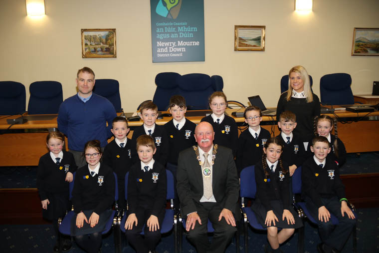 Newry, Mourne and Down District Council Chairperson, Councillor Charlie Casey, Principal Paul Shields, School Council Teacher, Sinead McNally and pupils from St Mary's PS, Barr on a visit to Council's Chamber in Newry.