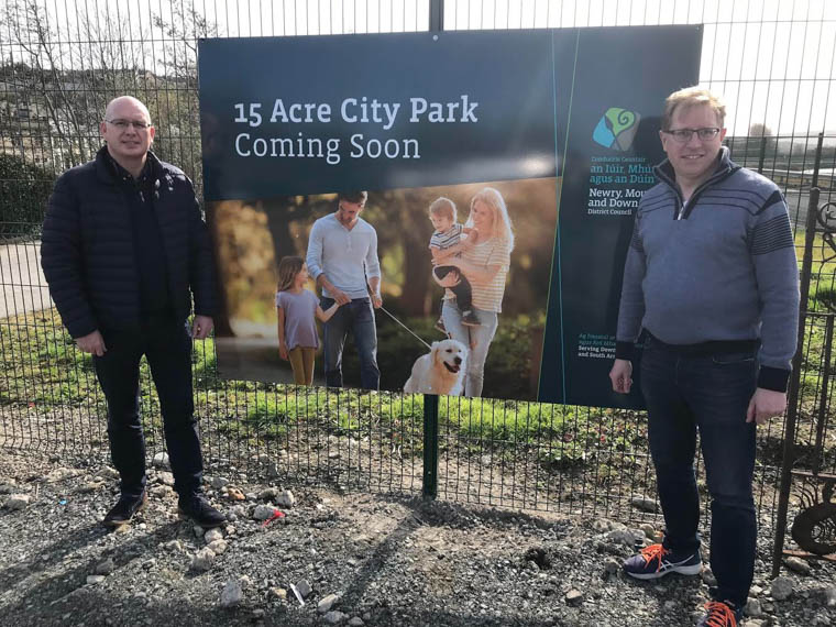Newry City Councillors Michael Savage and Gary Stokes at the entrance of the Albert Basin site.
