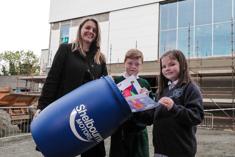 Pictured with Caroline Willis, Financial Director at Shelbourne Motors is Shane Kelly from St Patrick's Primary School and Lily McCartan from Mullaglass Primary School.