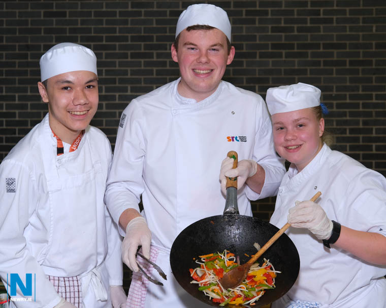 SRC Catering students Anthony Hutchinson, Rodney Hughes and Caóimhe Bailey keep the tasty food coming at a Positive Ageing Week event in Newry Leisure Centre. Photograph: Columba O'Hare/ Newry.ie