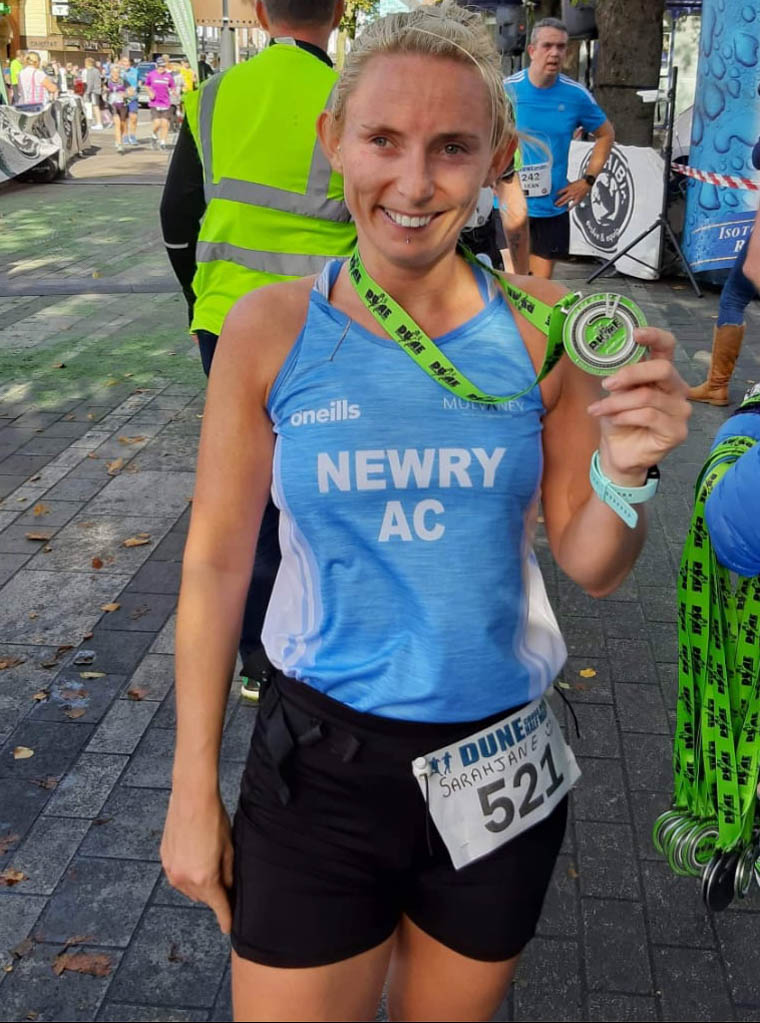 Sarah Jane Beattie well proud of her hard earned Dune Half Marathon medal on Sunday.