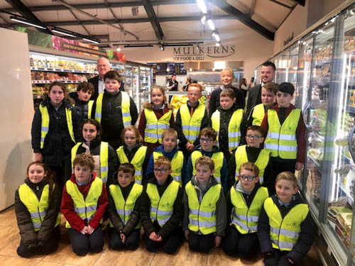 P7 class from Jonesborough Primary pictured with Terry Mulkerns & Mairead Mulkerns (Owners) & Ciaran Murtagh Store Manager.