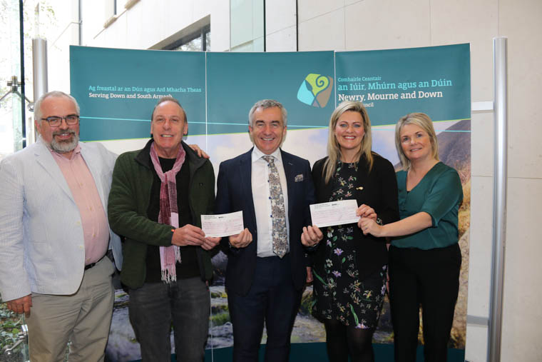 Former Chairman of Newry, Mourne and Down Council, Mark Murnin presents funds raised from his Charity Walk to his nominated charities Glebe House, Newry and District Gateway Club and Air Ambulance NI.  Pictured L-R: Seamus Camplisson Chairperson and Diarmaid McGarrigle, Glebe House; former Chairman of Council Mark Murnin; Colleen Milligan, area fundraising manager for Air Ambulance NI and Sheila Kieran Democratic Services Officer. Each charity received a cheque for £3,930 and the third charity Newry & District Gateway Club also received a £3,930 cheque (not pictured).