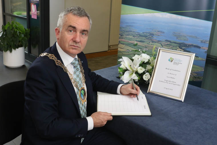 Cllr Mark Murnin, Chairperson, Newry, Mourne and Down Council adds his name to a Book of Condolence in memory of Lyra Mckee. Photograph: Jim Masson