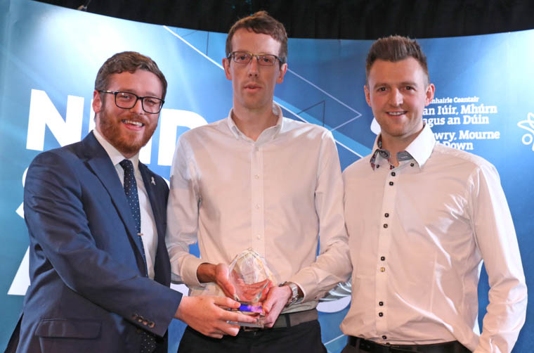 Councillor Gareth Sharvin, Chair of Newry, Mourne and Down District Council's Active and Healthy Communities Committee, presents the Senior Club Team of the Year 2018 award to Gareth Russell and Mark Stevenson, Kilkeel Hockey Club 1st XI.