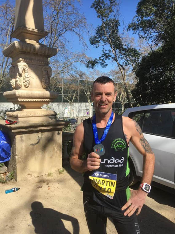 Martin Campbell at finish line in Barcelona.