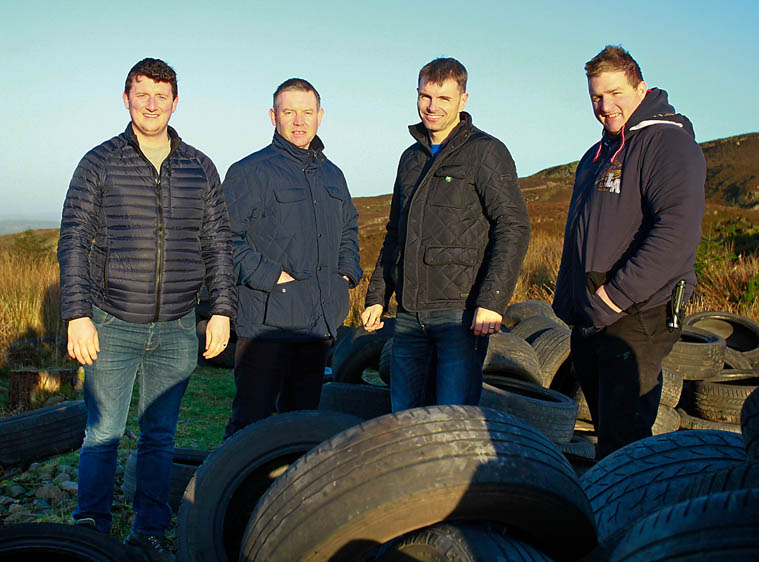 Cllr Antóin Watters, Cllr Micky Larkin, Cllr Ruairí Ó Murchú & David Loughran pictured with tyres dumped along the border.