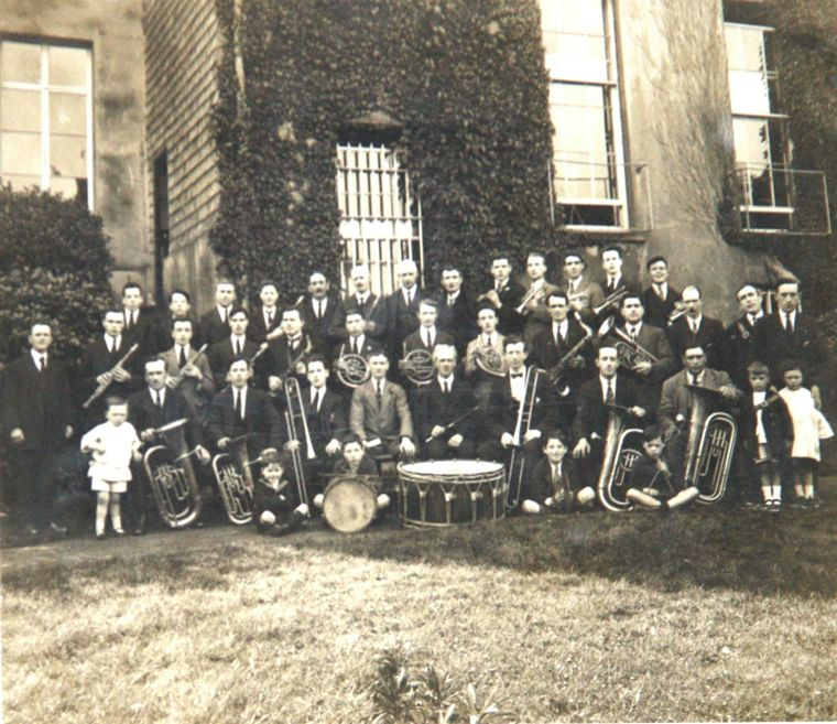 St. Catherine's Brass and Reed Band, c.1923, photographed after their success at their first competition, which was held in the Y.M.C.A. Hall, Belfast. Newry and Mourne Museum Collection