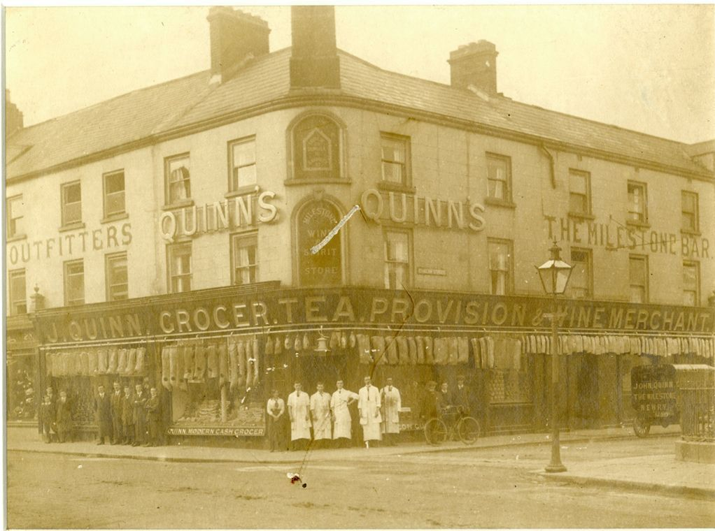Quinn's The Milestone c. 1920s showing staff, and sides of meat.  Newry and Mourne Museum