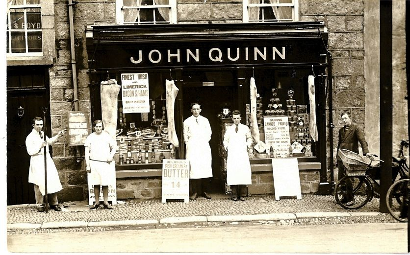 John Quinn's shop, Newry Street, Kilkeel in the 1920s. L- R: Jim Morgan, Josephine Sloane, Pat Murphy (Manager), Danny Doran and Pat Joe McLaughlin. Courtesy of Matthew and Nora Murphy