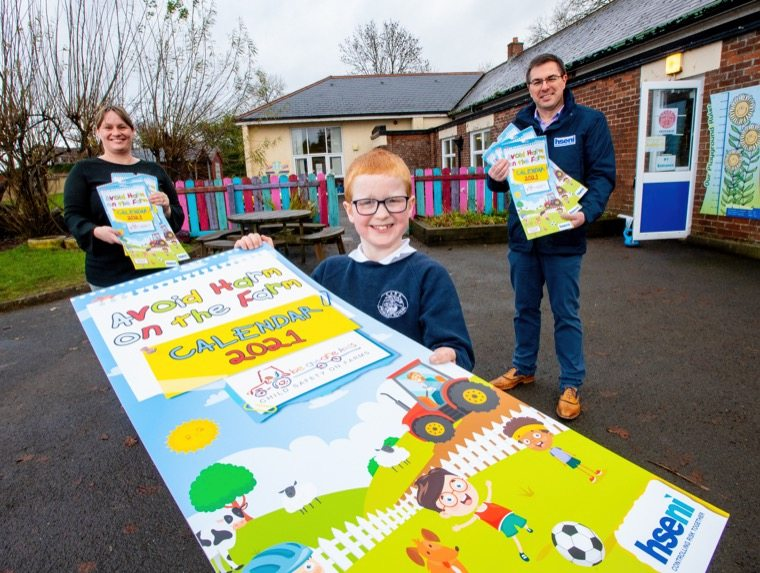 "Pictured at the launch of the ""Avoid Harm on the Farm"" Child Safety 2021 Calendar is (L-R) Joanne Bryans, Principal, Carr PS, Daniel Glenn, Carr PS, and Robert Kidd, Chief Executive HSENI."