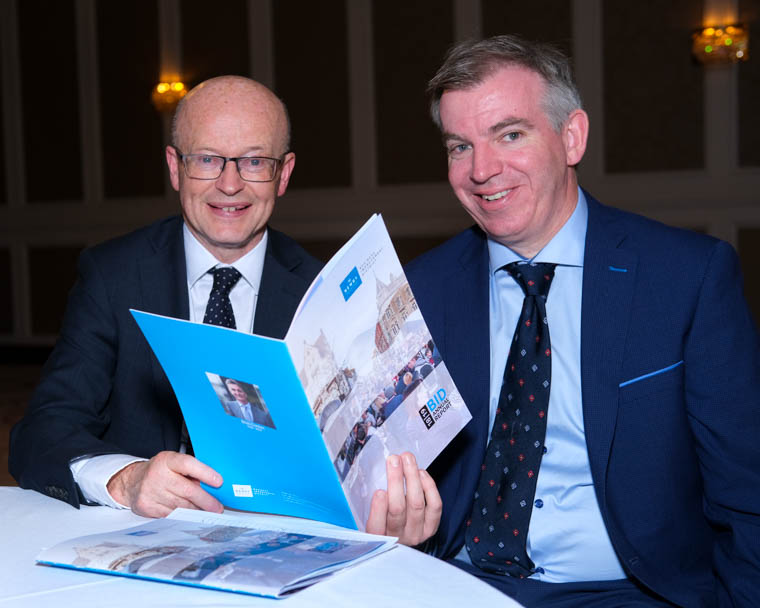 Peter Murray,  Newry BID Chairperson and Eamonn Connolly, Newry BID Manager check over the Annual Report at the Newry BID AGM in the Canal Court Hotel in Newry. Photograph: Columba O'Hare/ Newry.ie