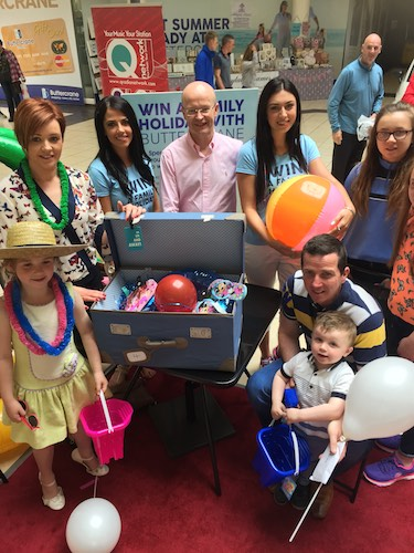 Michelle Toner and family pictured with Peter Murray, Buttercrane Centre Manager at Saturday's live draw for a £2,000 holiday.