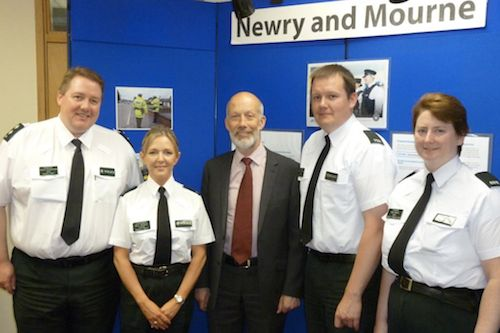 Pictured are members of Newry Neighbourhood Policing Team, Inspector David Hutchinson, Con Michaela Wilson, Con Ruairi Cousins and Con Mary Marner with Justice Minister David Ford MLA.