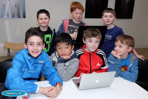 Pictured in Newry Library were some of the participants in the Newry 2020 Minecraft competition where teams will design a City Park for the Albert Basin site in Newry. Front from left:  Luka Doran, Joseph Wang, Ethan Lynch and Charlie Lynch. Back: Ciaran, Rory and Eoin Campbell. Photograph: Columba O'Hare