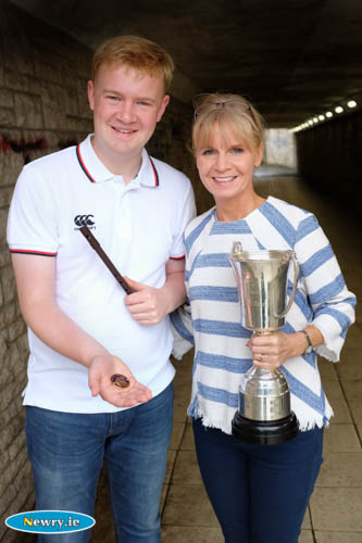 Oisin McCann and mum Kirsty McDonald with his All Ireland Medal and Cup for the Whistle. Photograph: Columba O'Hare