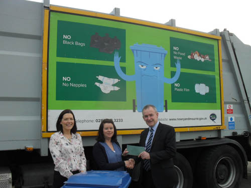 Roisin Austin who has been named Recycler of the Month is presented with her £50 prize by Newry, Mourne and Down District Council Recycling Officers Tara Cunningham and Liam Dinsmore