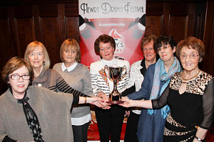 Maureen Grant holding the Trophy with Maire Donaghy, Stephanie Henaghan, Patricia Slevin, Eileen Mooney, Christine Farrelly, Marie Magennis.