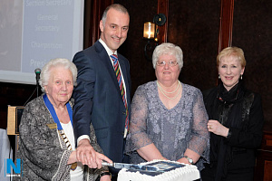 Alma Brown, President, Newry Musical Feis cuts the cake to celebrate the start of the 90th year of the Feis at a function in 2017 while looking on are Lowry Hodgett, Marie Graham, Chairperson and Mary Goss, Administrator. Photograph: Columba O'Hare