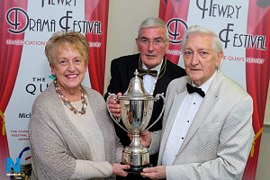 Barbara McCombe, Bunclody, Kilymyshall Drama Group receives the trophies won by the group at the 2017 Newry Drama Festival from Gerry McNulty, President, Newry Drama Festival and Scott Marshall, festival Adjudicator. Photograph: Columba O'Hare