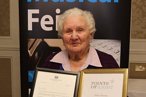 Alma Brown, Newry Musical Feis with her Point of Light Award.