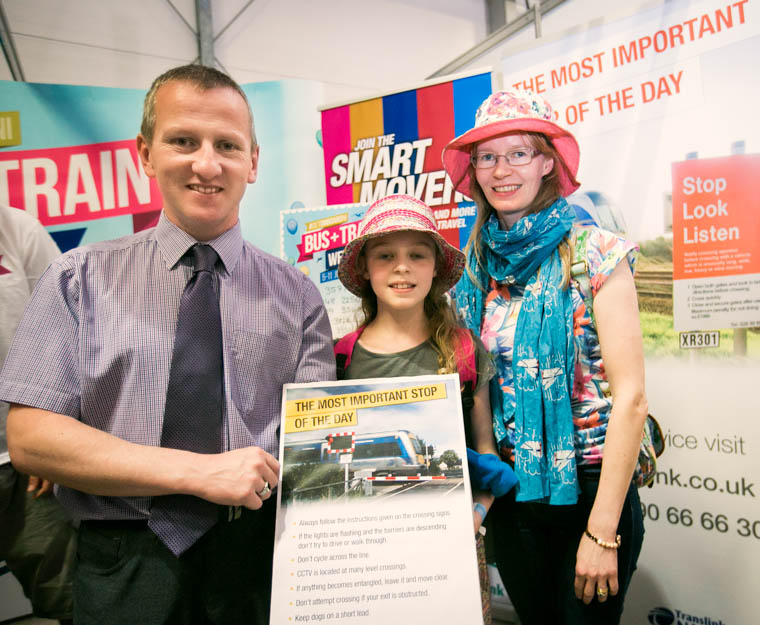 Translink Level Crossing Risk Coordinator Keith Pollock (L), explains the importance of rail safety to Charlotte (9) and Janice Hull from Poyntzpass, at the Balmoral Show.