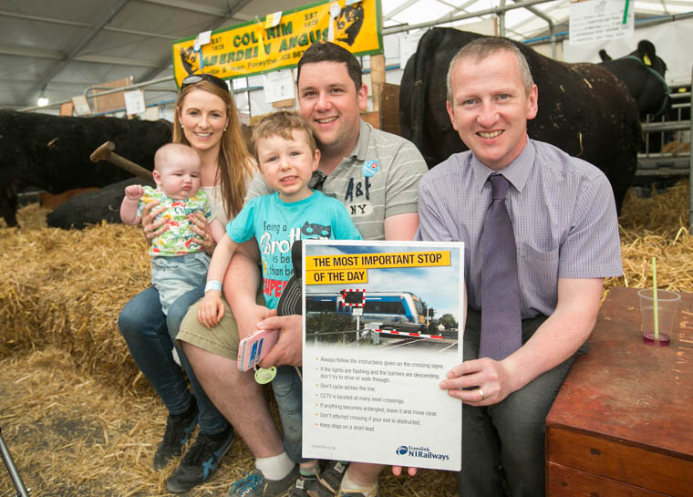 Translink Level Crossing Risk Coordinator Keith Pollock (R), explains the importance of rail safety to Karen and Michael Finnegan from Camlough, Newry, who were at the Balmoral Show with their children Daithi (5 months) and James (3)
